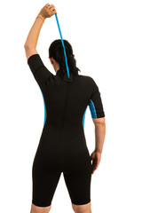 Surfer closing zipper to neoprene suit