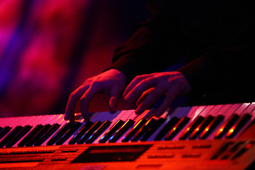 Playing on keyboard on stage