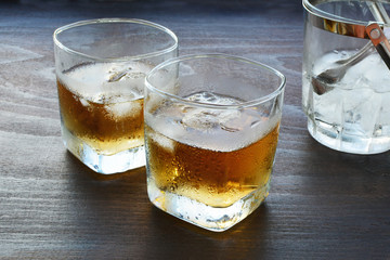 Glass of whiskey over ice