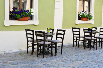 Outdoor street cafe tables and chairs