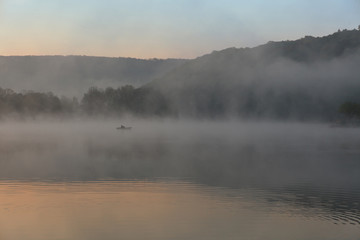 Foggy lake at sunrise