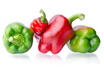 juicy green and red peppers isolated on white background