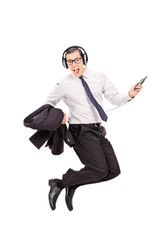 Ecstatic businessman listening music on his phone