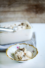Vanilla ice cream with truffles, homemade in a rustic bowl