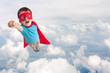 Leinwanddruck Bild - superhero child boy flying