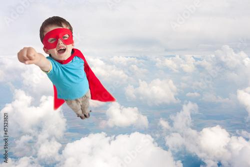 Leinwanddruck Bild superhero child boy flying
