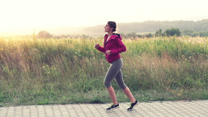 Woman jogging in the country, super slow motion, shot at 240fps