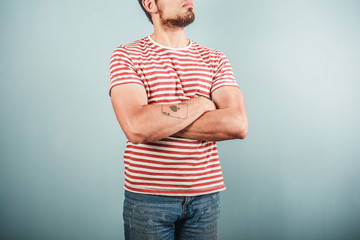 Man in striped shirt with arms crossed