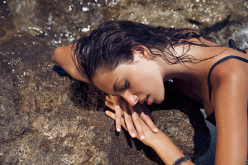 Carefree beautiful brunette with wet look