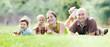Leinwanddruck Bild - Happy family of four in summer park