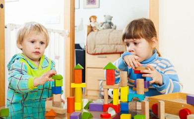 serious children playing with  blocks