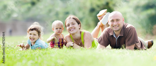 canvas print picture Happy family of four in summer park