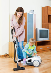 Mother with child cleaning home