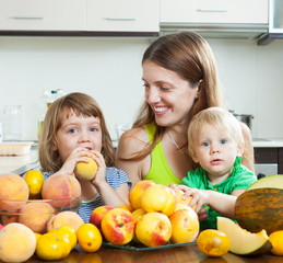 Mother and children with melon