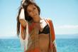 Fashionable young woman posing in bikin