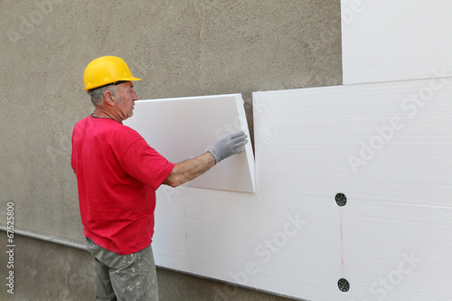 Styrofoam, polystyrene thermal insulation of house wall install - 67525800
