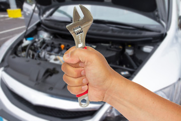 Auto mechanic hand with wrench