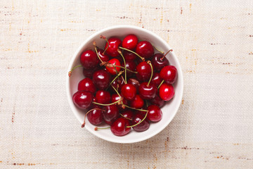 Fresh red cherries in bowl