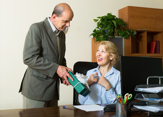 Office manager congratulating secretary