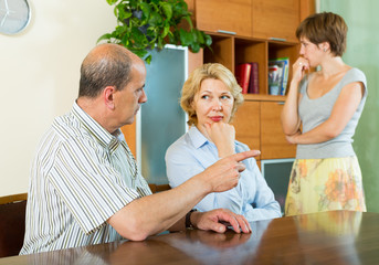 Adult daughter talking with parents