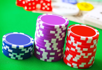 Group from chips for poker on the green background
