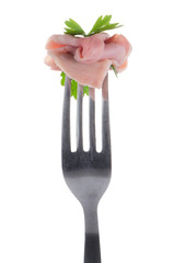 Slice of ham skewered on a fork