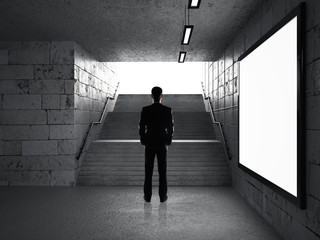 businessman in underground passage