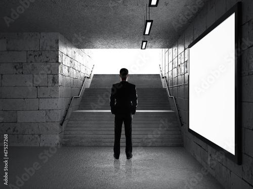 businessman in underground passage