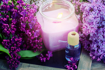 fresh lilac flowers spa setting with candle