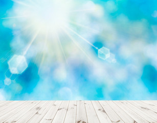 wooden platform with blue sky sunlight background