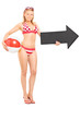 Woman in bikini holding a beach ball and an arrow