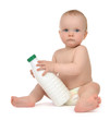 New born infant child baby girl toddler sitting bottle with milk