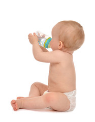 Infant child baby toddler sitting and drinking water from the fe