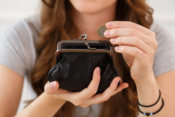 Money, finance. Girl with wallet