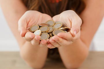 Money, finance. Girl with heap of coins