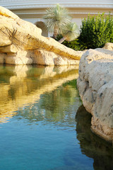 Beautiful landscaping. Lake with stone bridge