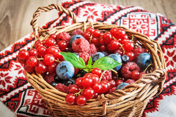 Ripe summer berries in basket