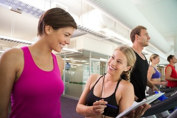 Trainer talking to her client on the treadmill