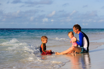 Father and kids on sea vacation