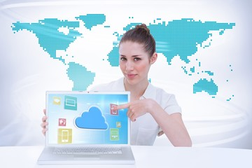 Composite image of businesswoman showing a laptop