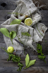 Plants vegetables and lemon composition on rustic set