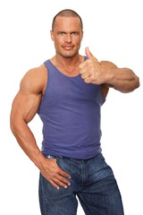 Muscular man in undershirt shows you thumb up