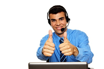 Young smiling customer service operator shows you thumbs up
