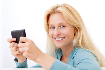 View of Young relaxed woman sending text