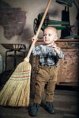 Sweeping little boy