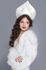 Beautiful Russian girl model in fur coat and exclusive design cl