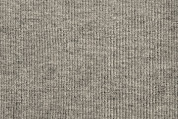 abstract texture of knitted fabric beige color