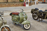 Fototapety Old Vintage green motorcycle on the streets
