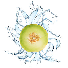 Fresh yellow melon with water splash