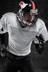 american football player running dark background